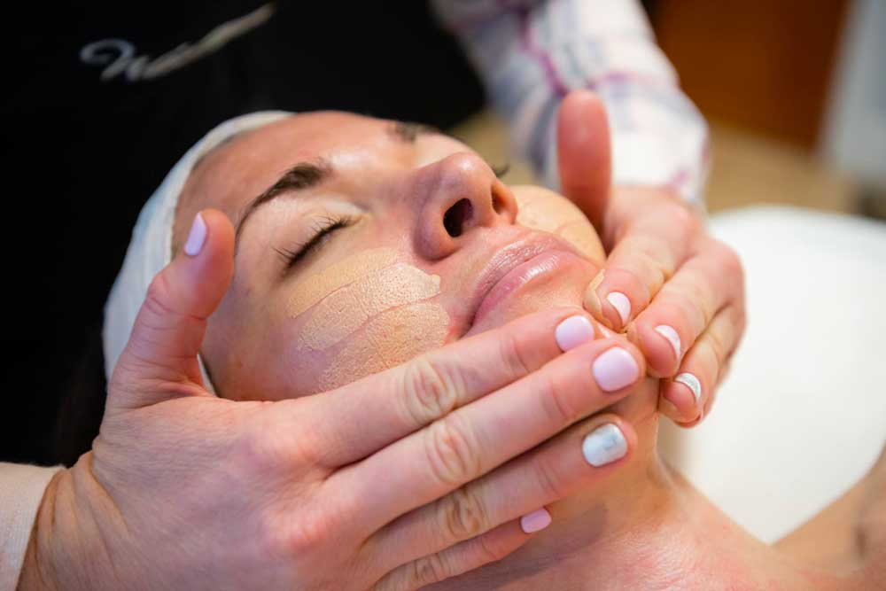 Leah giving facial at Waxapeel in Lafayette, CA